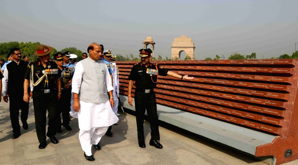 Defence Minister Rajnath Singh visits the area with slabs depicting names of the martyrs during the homage ceremony at the National War Memorial, in New Delhi on June 1, 2019. Also seen ... - Rajnath Singh