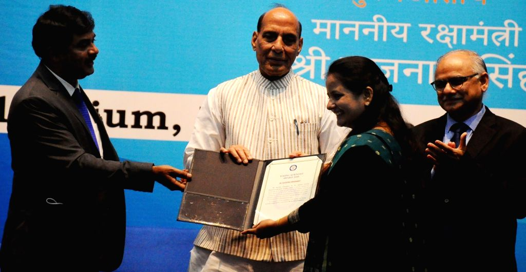 Defence Minister Rajnath Singh with Chairman of DRDO G Satheesh Reddi(L)  presenting  Dare to Dream 2.0 awards and Young Scientist awards of DRDO,in New Delhi on Monday October 04 2021. - Rajnath Singh