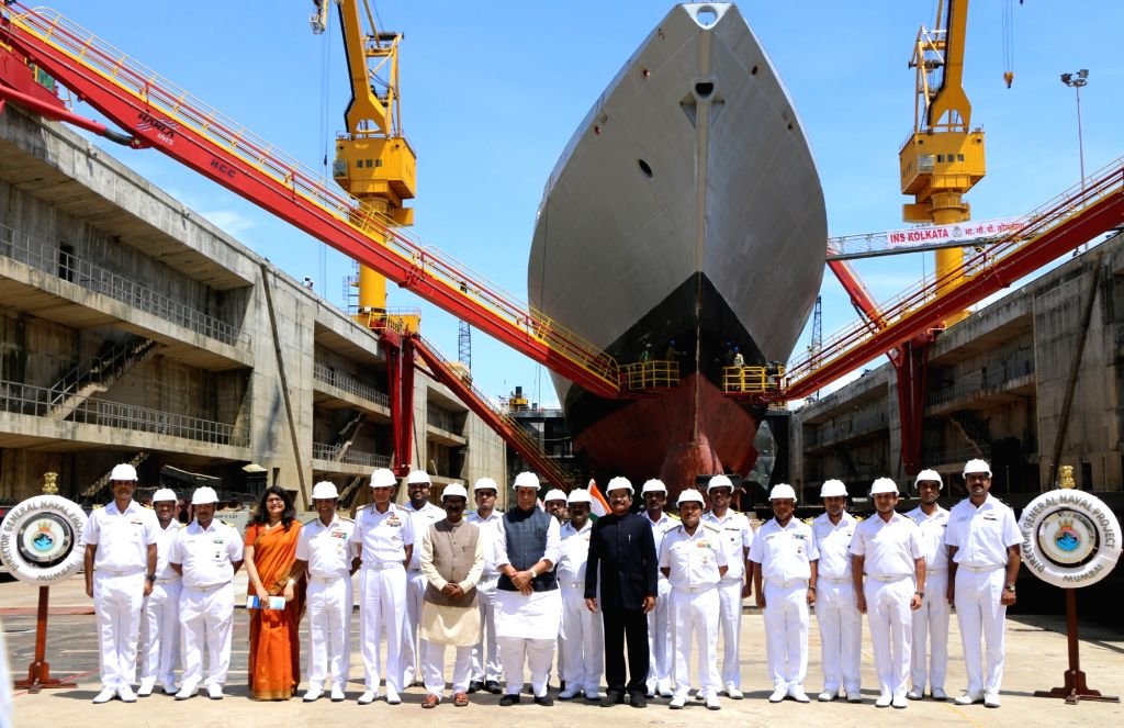 Defence Minister Rajnath Singh with senior officials of Indian Navy at the inauguration of the Aircraft Carrier Dry Dock, at Naval Dockyard, in Mumbai on Sep 28, 2019. - Rajnath Singh