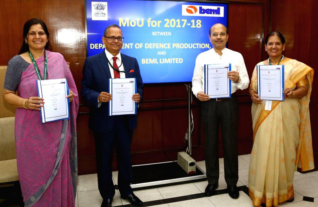 Defence Production Secretary Ashok Kumar Gupta and CMD, Bharat Earth Movers Limited (BEML), DK Hota signs a Memorandum of Understanding in New Delhi, on July 4, 2017. Also seen Also seen ... - Kusum Singh