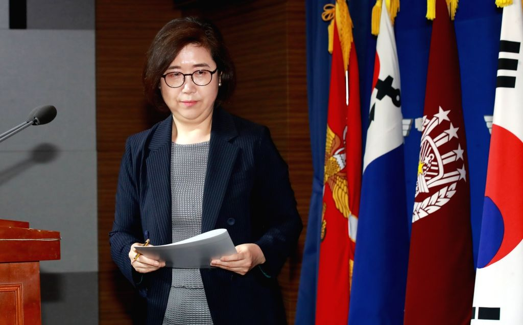 Defense Ministry spokeswoman Choi Hyun-soo leaves after a briefing at the ministry in Seoul on July 23, 2018, to announce the launch of a military-prosecution joint investigation team to probe ...
