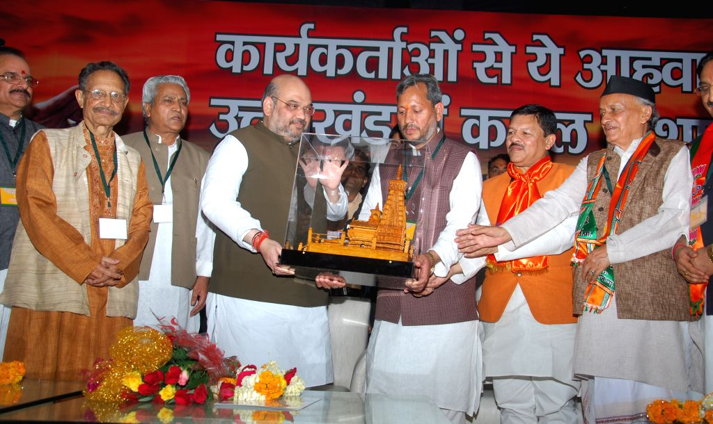 BJP chief Amit Shah, Uttarakhand BJP chief Tirath Singh Rawat and others during a party programme in Dehradun, on May 3, 2015. - Tirath Singh Rawat