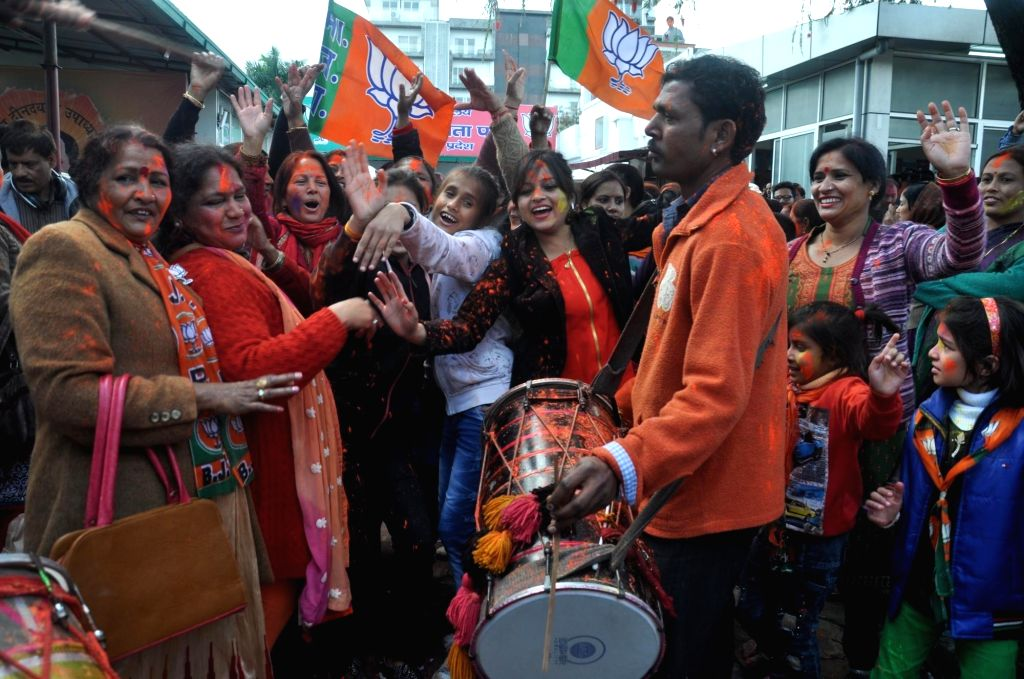 :Dehradun: BJP supporters celebrate as assembly election results being announced in Dehradun on March 11, 2017. (Photo: IANS).