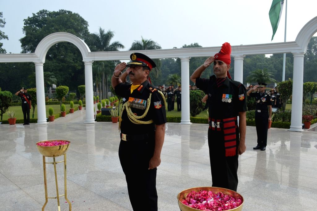 """Dehradun: Commandment Lt. General S.K. Jha pays tributes to martyrs during a ceremony organised to commemorate the 20th anniversary of the successful culmination of Operation Vijay, more commonly known as the """"Kargil War"""" at the Indian Military Acade"""