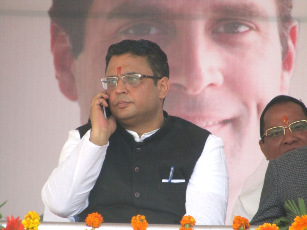 Dehradun: Manish Khanduri, the son of former Uttarakhand Chief Minister B.C. Khanduri, who joined the Congress in the presence of party President Rahul Gandhi at an election rally in Dehradun, on March 16, 2019. (Photo: IANS) - B. and Rahul Gandhi
