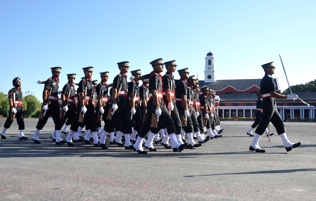 Dehradun: Newly commissioned officers march during their Passing Out Parade at Indian Military Academy in Dehradun on June 10, 2017. (Photo: IANS)
