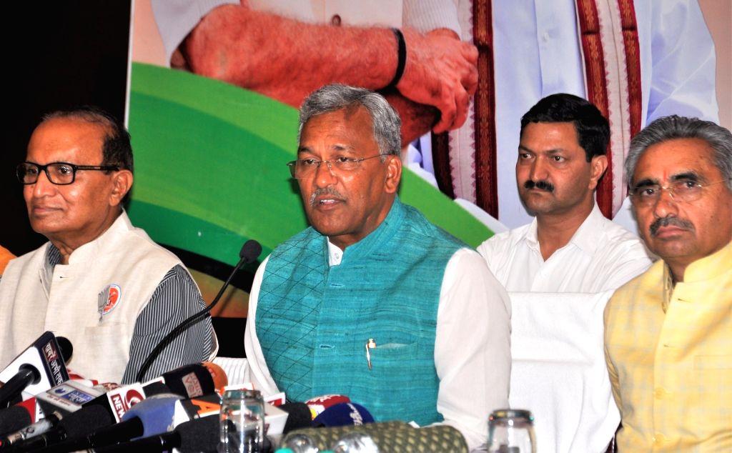 Dehradun: Uttarakhand Chief Minister and BJP leader Trivendra Singh Rawat addresses a press conference in Dehradun, on April 6, 2019. (Photo: IANS) - Trivendra Singh Rawat