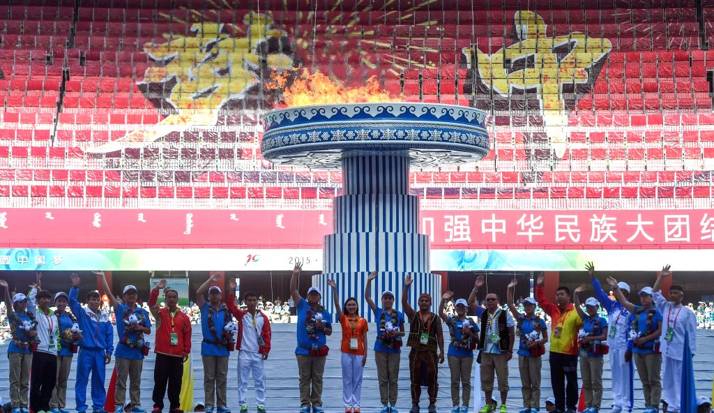 Delegates wave on the closing ceremony of the 10th National Traditional Games of Ethnic Minorities of China in Ordos, north China's Inner Mongolia Autonomous Region, ...