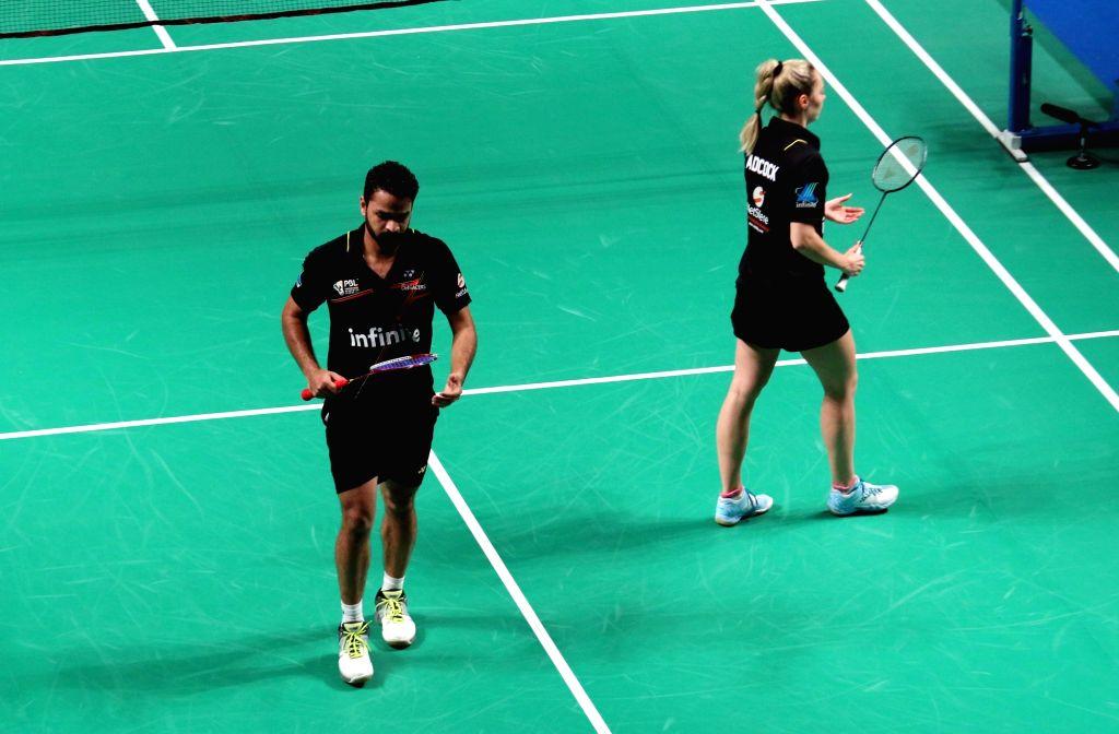 Delhi Acers' Akshay Dewalkar and Gabrielle Adcock during a Premier Badminton League match against Kamilla Rytter Juhl and Vladimir Ivanov of Mumbai Rockets  in New Delhi, on Jan 17, 2016. ...