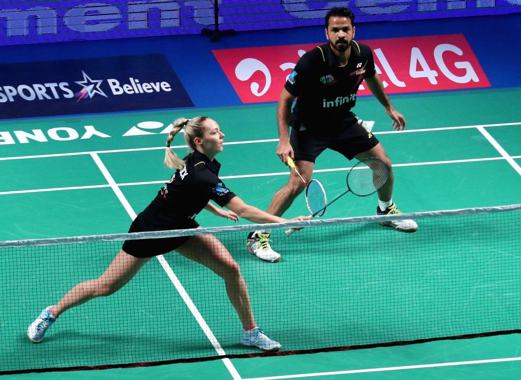 Delhi Acers' Akshay Dewalkar and Gabrielle Adcock in action against Kamilla Rytter Juhl and Vladimir Ivanov of Mumbai Rockets during a Premier Badminton League match in New Delhi, on Jan ...