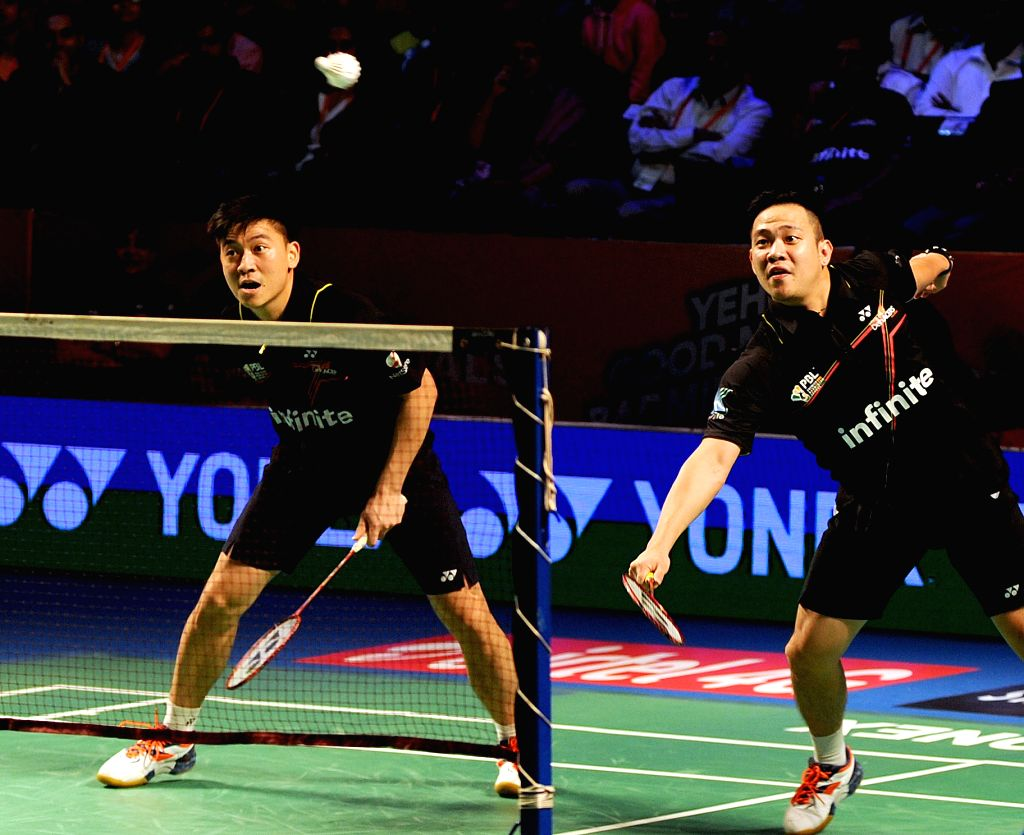 Delhi Acers Koon Keat Kien and Tan Boon Heong in action against Chennai Smashers during a Premier Badminton League match at Kanteerava Stadium in Bengaluru, on Jan 14, 2016.