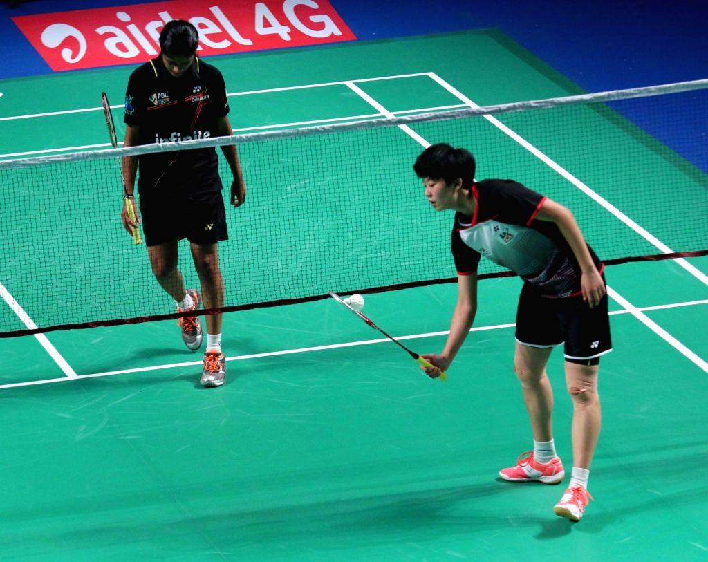 Delhi Acers' P C Thulasi and Han Li of Mumbai Rockets during Premier Badminton League final match in New Delhi, on Jan 18, 2016. Mumbai Rockets won.