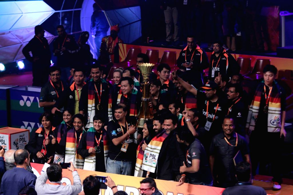 Delhi Acers pose for a group photo with the Premier Badminton League trophy  at Siri Fort Sports Complex in New Delhi, on Jan 17, 2016.