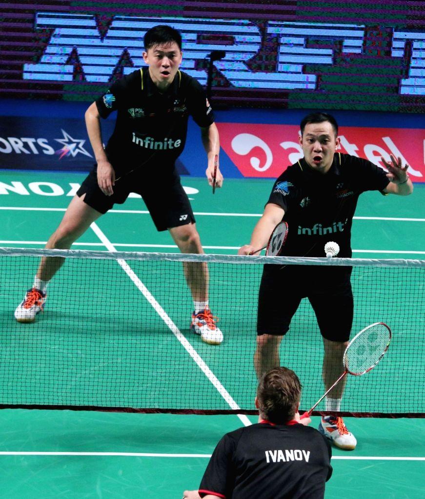 Delhi Acers' Tan Boon Heong and Koo Keat Kien in action against Mathias Boe and Vladimir Ivanov of Mumbai Rockets during a Premier Badminton League match in New Delhi, on Jan 17, 2016. ...