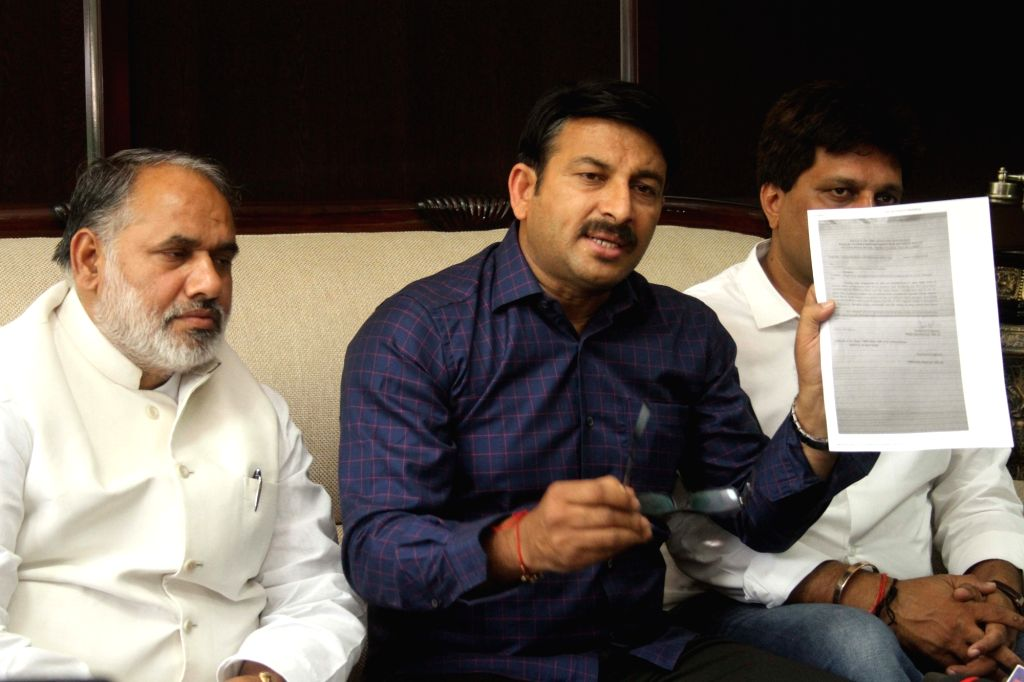 Delhi BJP chief Manoj Tiwari addresses a press conference in New Delhi on May 13, 2017.