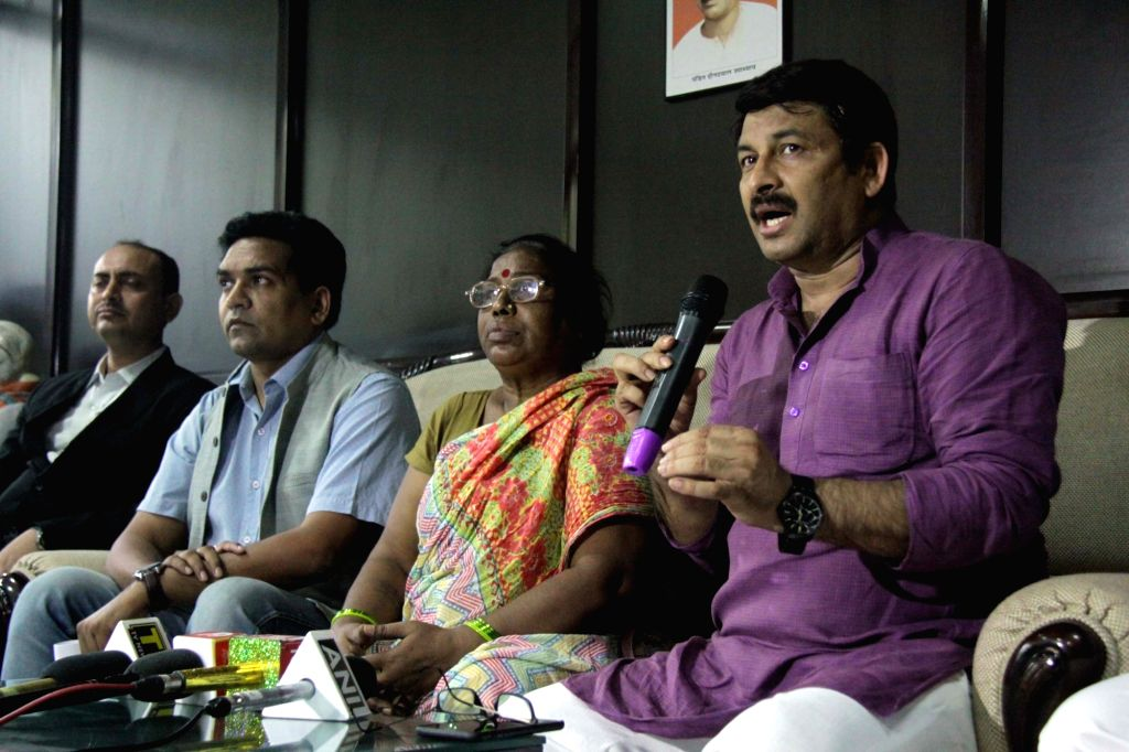 Delhi BJP chief Manoj Tiwari addresses a press conference, along with former AAP leader Kapil Mishra, in New Delhi on Sept 18, 2018. - Kapil Mishra