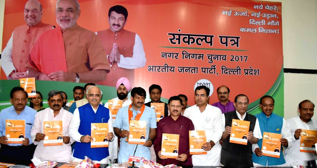 Delhi BJP chief Manoj Tiwari along with other party leaders at the launch of party's manifesto for upcoming Delhi MCD Polls in New Delhi on April 16, 2017.