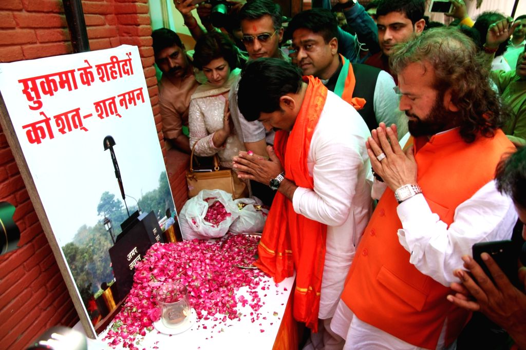 Delhi BJP chief Manoj Tiwari and sufi singer and party leader Hans Raj Hans pay tributes to the martyred CRPF personnel in New Delhi on April 26, 2017. 25 personnel of CRPF's 74th ...
