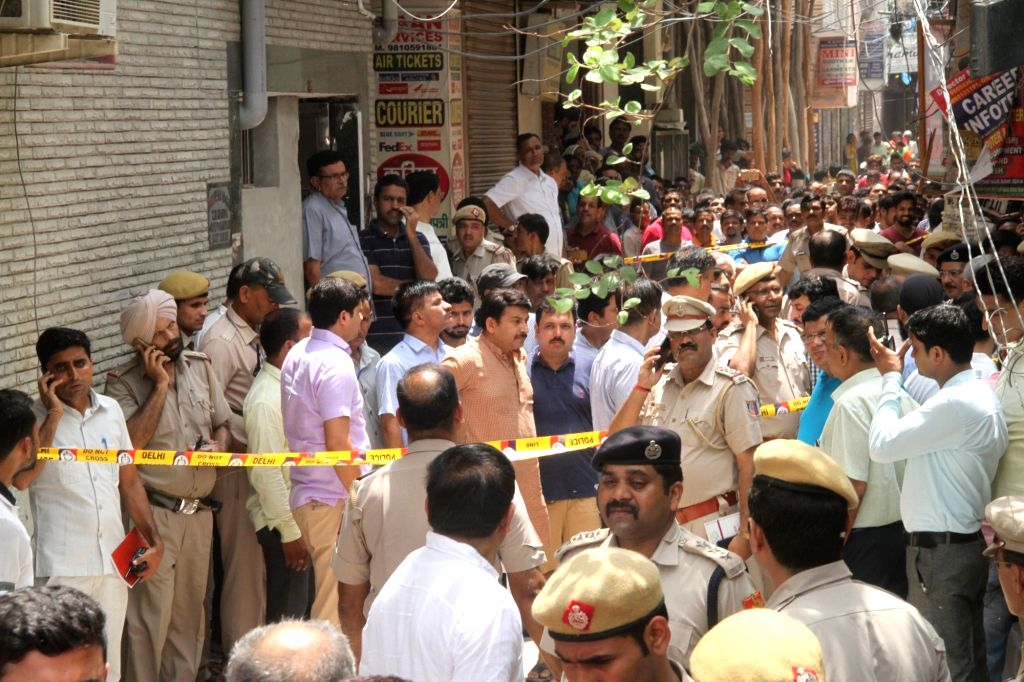 Delhi BJP chief Manoj Tiwari  during his visit to the site where 11 members of a family were found deadsome blindfolded and hanging from an iron grill ceilingat their home, in New ...