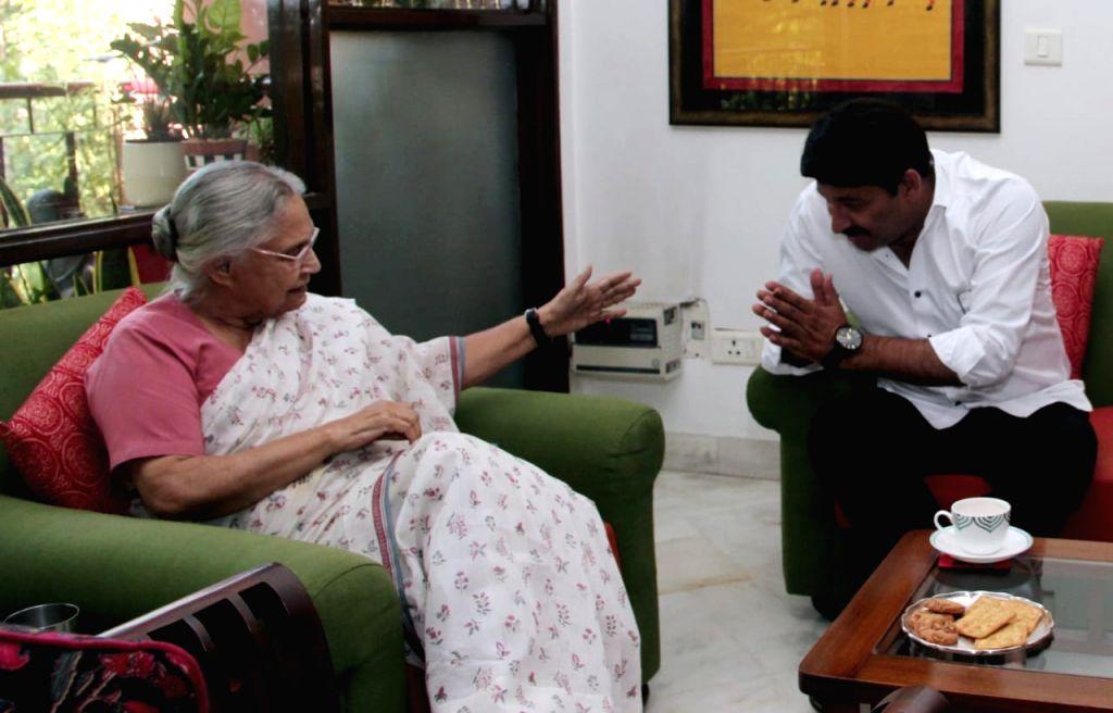 Delhi BJP chief Manoj Tiwari meeting Delhi Congress chief Sheila Dikshit in New Delhi on May 25, 2019. - Sheila Dikshit