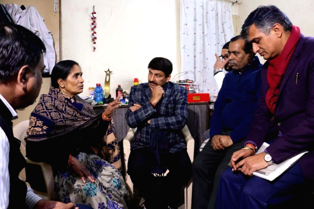 Delhi BJP chief Manoj Tiwari meets Nirbhaya's parents Asha Devi and Badrinath Singh at their residence in New Delhi. A Delhi court issued death warrants against all four convicts in the 2012 Nirbhaya ... - Badrinath Singh