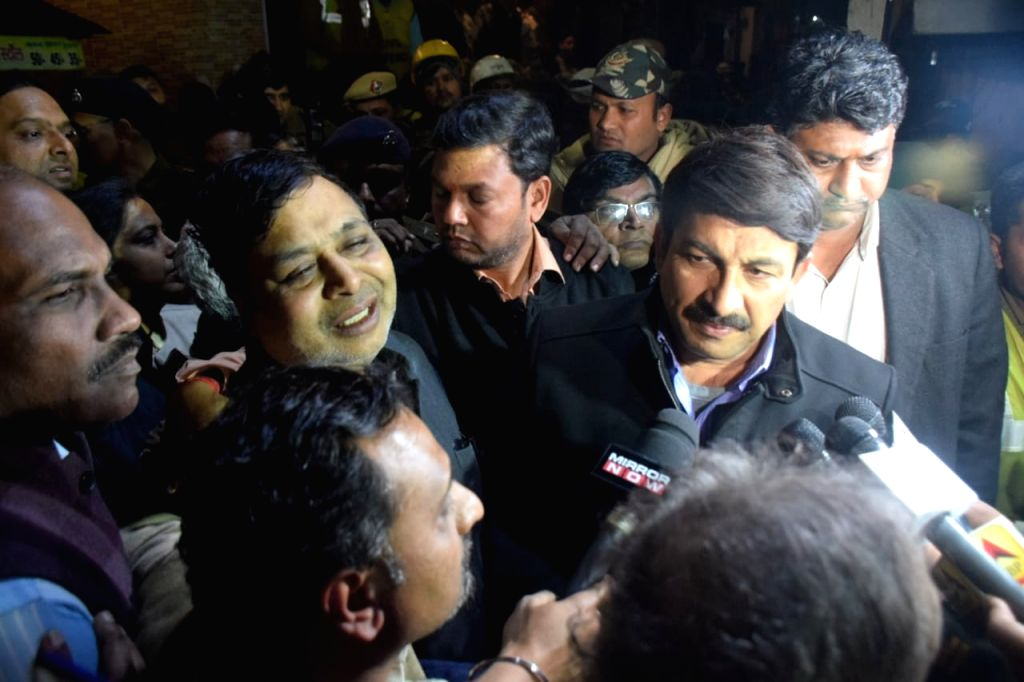Delhi BJP chief Manoj Tiwari visits the site where an under-construction building collapsed, in north-east Delhi's Bhajanpura area on Jan 25, 2020.Ten persons were injured in the mishap.