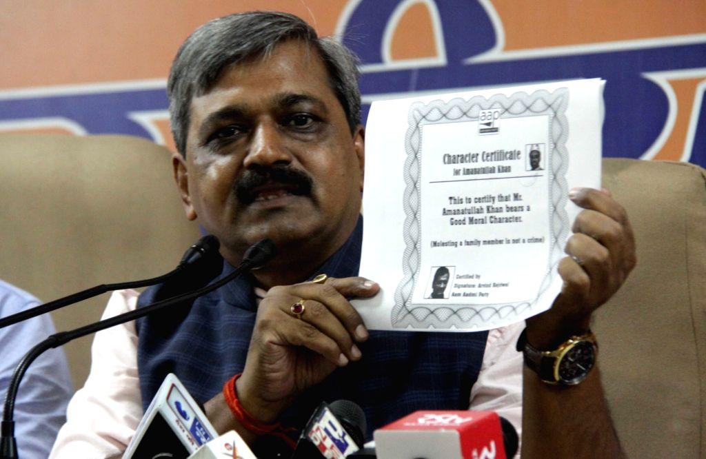 Delhi BJP chief Satish Upadhyay addresses a press conference in New Delhi on Sept 12, 2016. - Satish Upadhyay