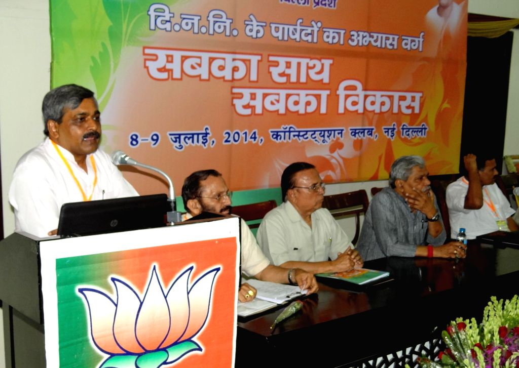 Delhi BJP chief Satish Upadhyay addresses during a workshop being held for the Councilors at Constitution Club in New Delhi on July 9, 2014. - Satish Upadhyay