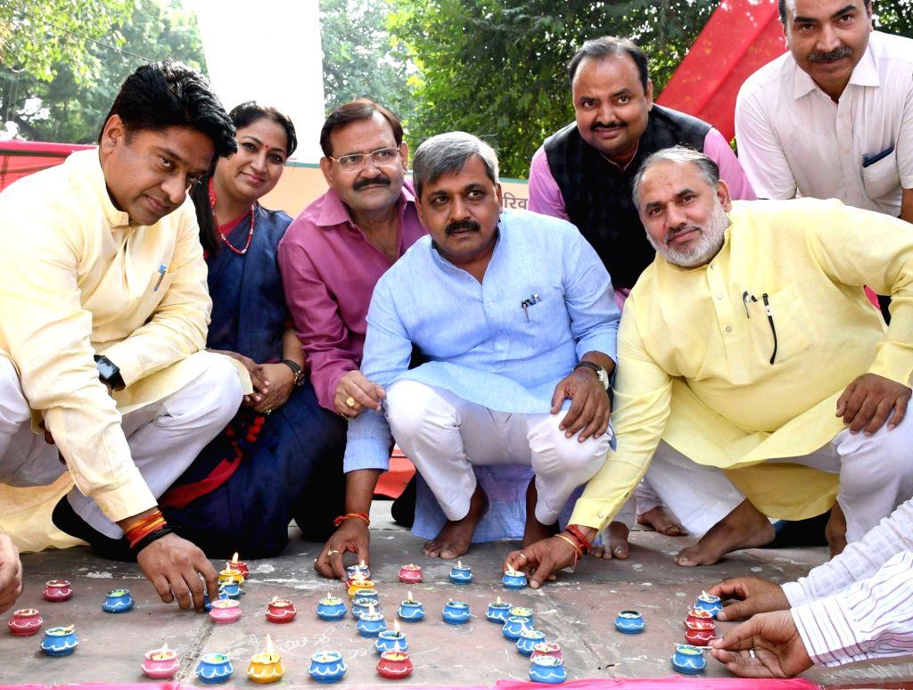 Delhi BJP chief Satish Upadhyay celebrates Diwali in New Delhi on Oct 27, 2016. - Satish Upadhyay