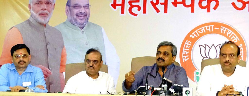 Delhi BJP chief Satish Upadhyay, Leader of the Opposition in Delhi Legislative Assembly Vijender Gupta and MLA Om Prakash Sharma during a press conference in New Delhi, on Aug 10, 2015. - Satish Upadhyay and Prakash Sharma
