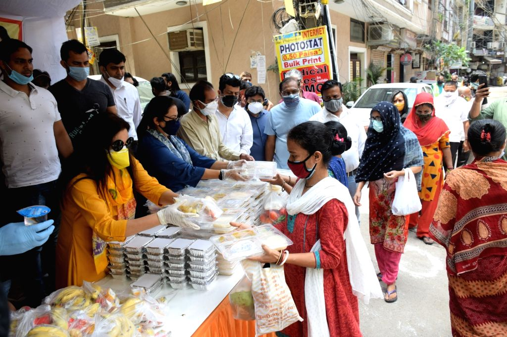 Delhi BJP MP Meenakshi Lekhi start food service for the family of Corona infected patients at Gautam Nagar in New Delhi on Thursday 13 May 2021.