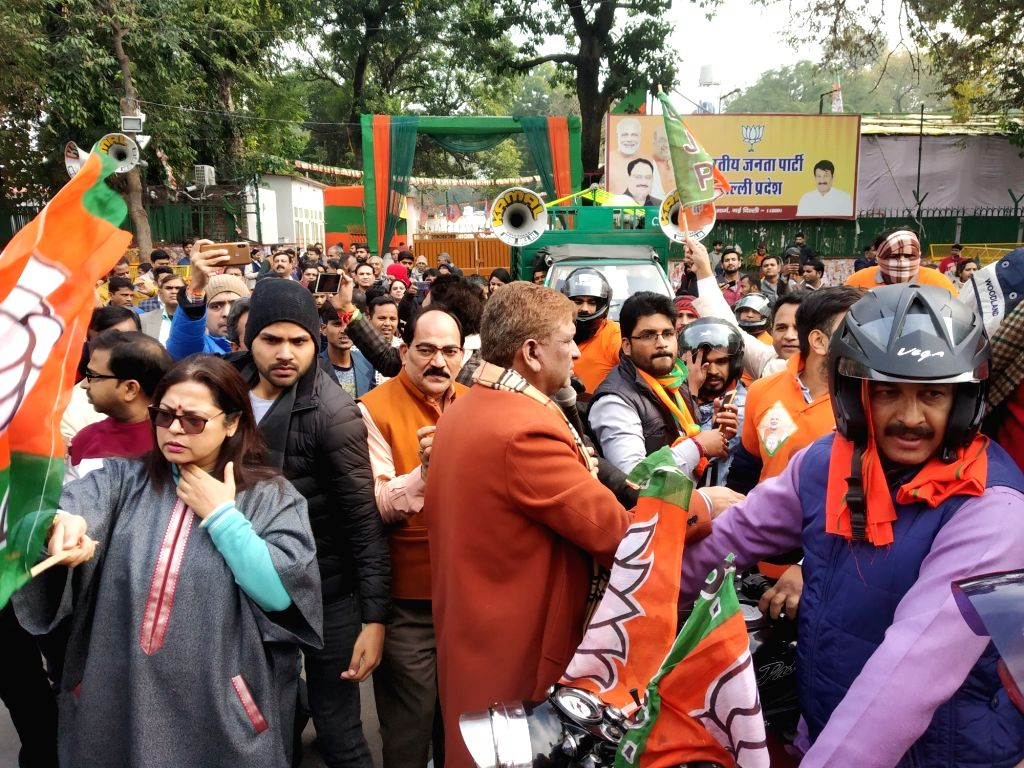 Delhi BJP MPs Manoj Tiwari and Meenakshi Lekhi participate in the party's bike rally organised ahead of the upcoming Delhi Assembly elections, on Jan 9, 2020.