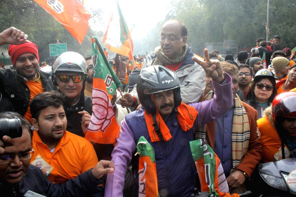 Delhi BJP MPs Manoj Tiwari, Vijay Goel and Meenakshi Lekhi along with party workers, participate in the party's bike rally organised ahead of the upcoming Delhi Assembly elections, on Jan ...