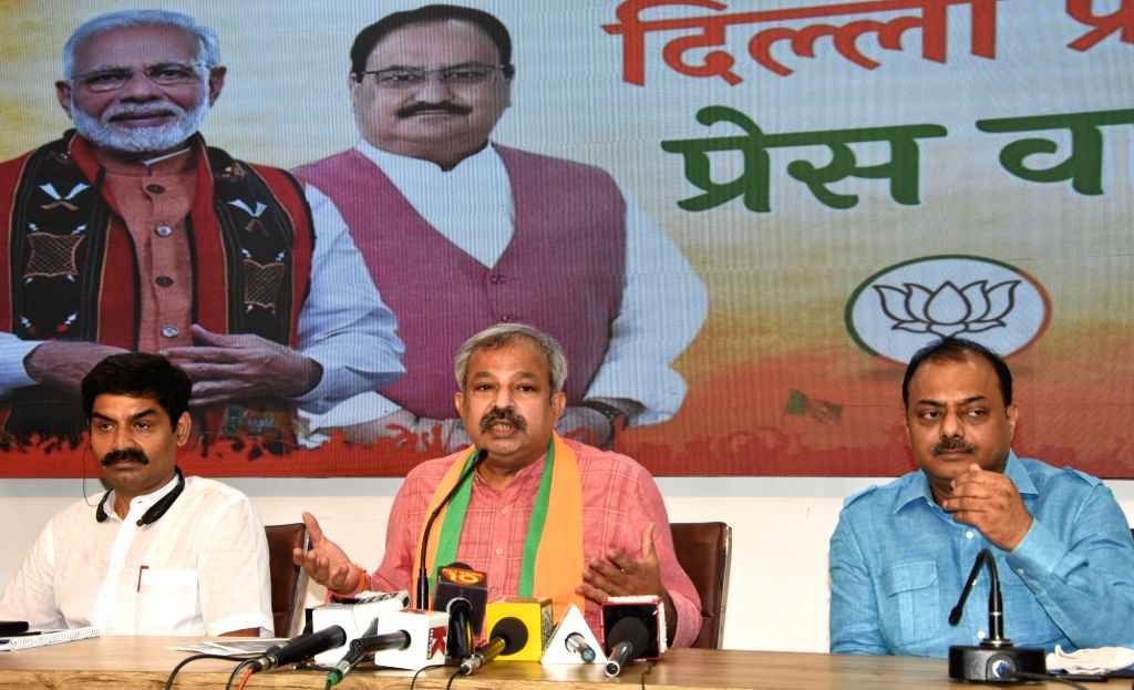 Delhi BJP President Adesh Gupta and others address a press conference on an important issue at BJP state office in New Delhi on Friday June 18, 2021. - Adesh Gupta