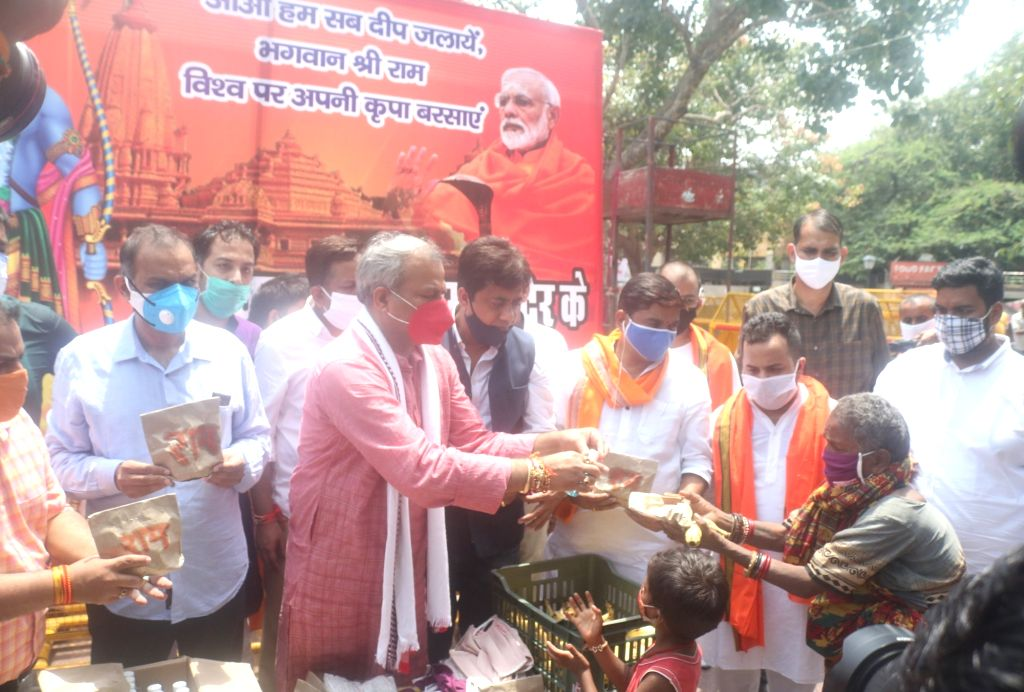 Delhi BJP president Adesh Gupta distributes face masks, sanitisers and earthen lamps among needy people on the eve of Bhumi Pujan of Ram temple in Ayodhya; in New Delhi on Aug 4, 2020. - Adesh Gupta