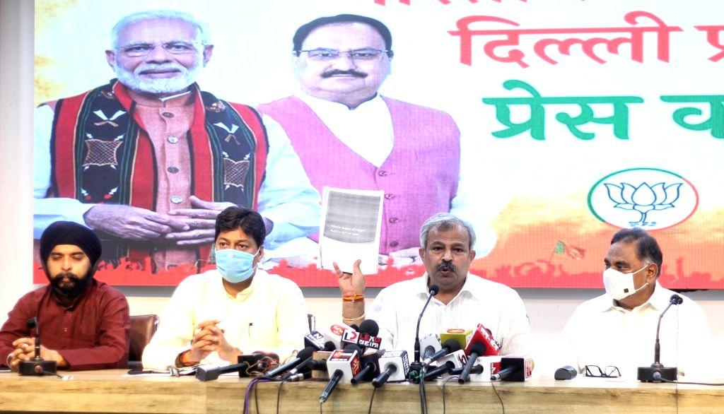 Delhi BJP President Adesh Gupta, LOP, Ramvir Singh Bidhuri and others address a press conference on an important issue at BJP Delhi Office in New Delhi on Friday June 25, 2021. - Adesh Gupta and Ramvir Singh Bidhuri
