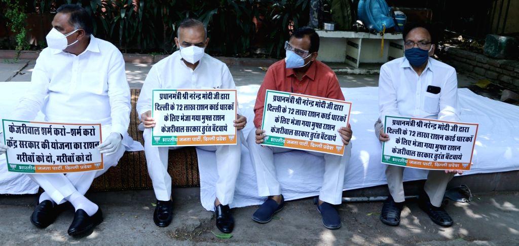 Delhi BJP President, Adesh Gupta, LoP, Ranveer Singh Bidhuri along with all BJP MLAs will demonstrate against Kejriwal's false promise of giving Ration kit to the poor at CM 's house 6 ... - Adesh Gupta and Ranveer Singh Bidhuri