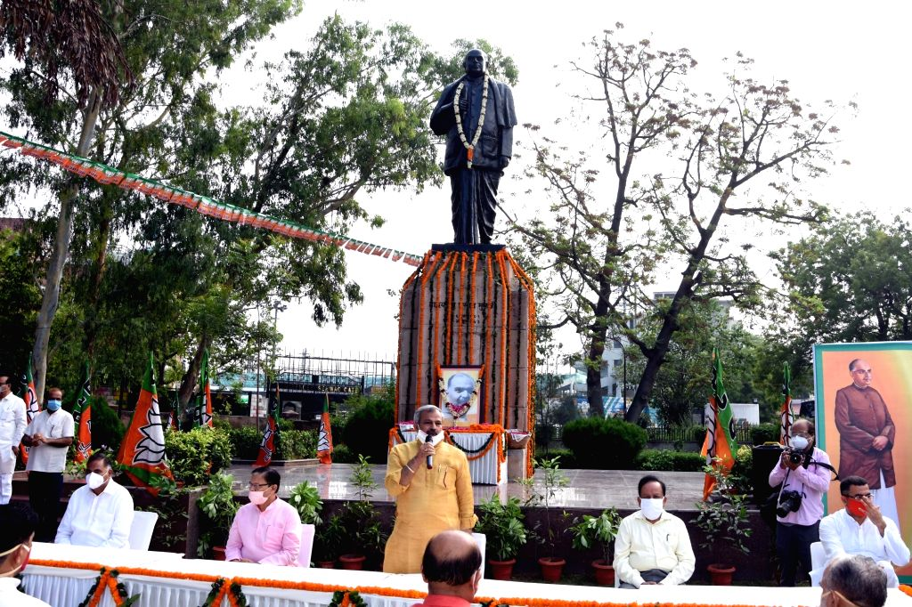 Delhi BJP President Adesh Kumar Gupta addresses at a remembrance ceremony organised on the death anniversary of Shyama Prasad Mukherjee in New Delhi on June 23, 2020. - Adesh Kumar Gupta and Shyama Prasad Mukherjee