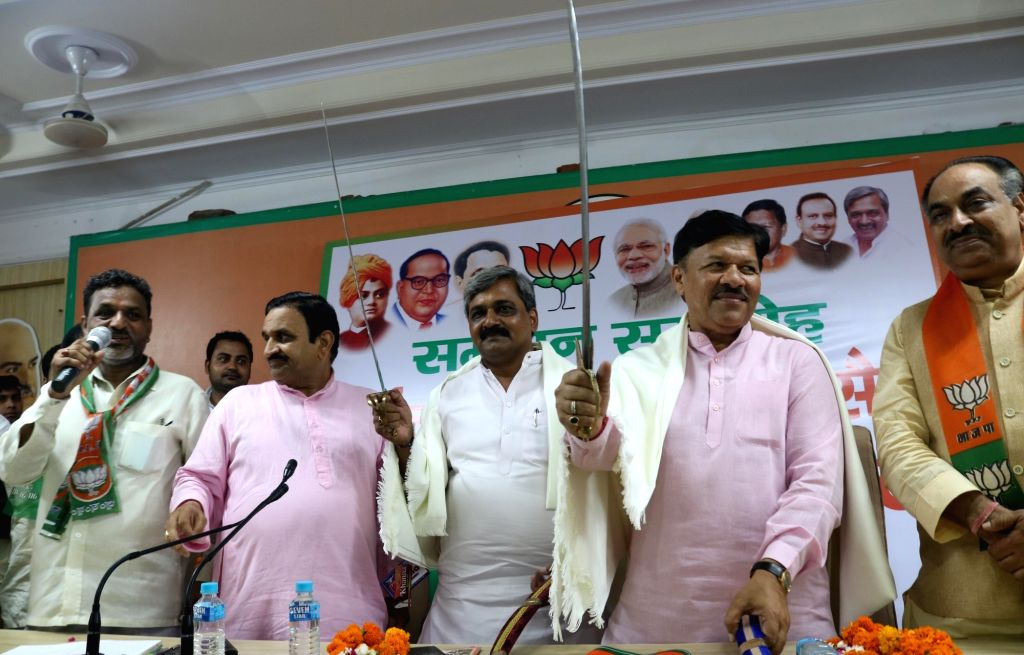 Delhi BJP president Satish Upadhyaya, BJP national vice-president Shyam Jaju and others attend a party programme in New Delhi, on June 27, 2016.