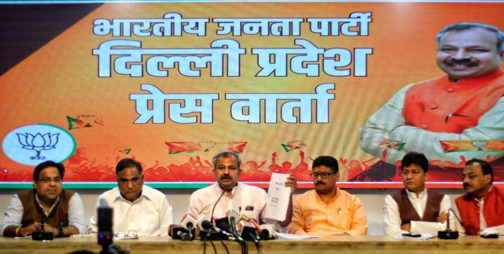 Delhi BJP state president Adesh Gupta, LoP Rambir Singh Bidhuri and others address a press conference about Liquor issue at BJP state office in new Delhi on Monday March 30, 2021. - Adesh Gupta and Rambir Singh Bidhuri