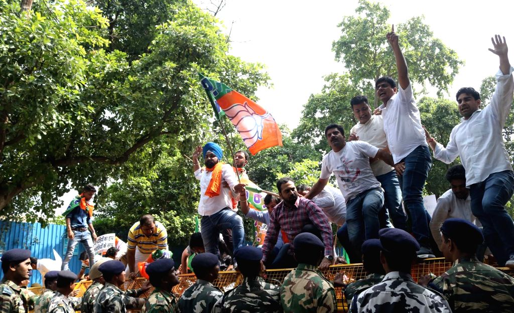 Delhi BJP Yuva Morcha activists staged a protest against Congress Party and Rajiv Gandhi Foundation in New Delhi, on Sept. 12, 2016. - Rajiv Gandhi Foundation