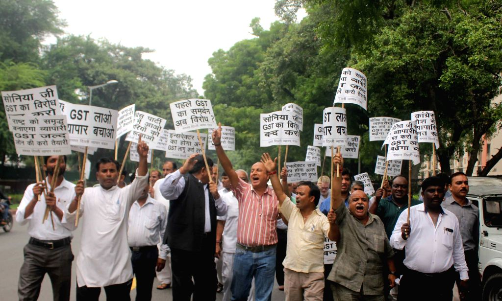 Delhi businessmen stage a demonstration against Congress for protesting against GST, in front of Nirman Bhawan  in New Delhi, on Aug 11, 2015.