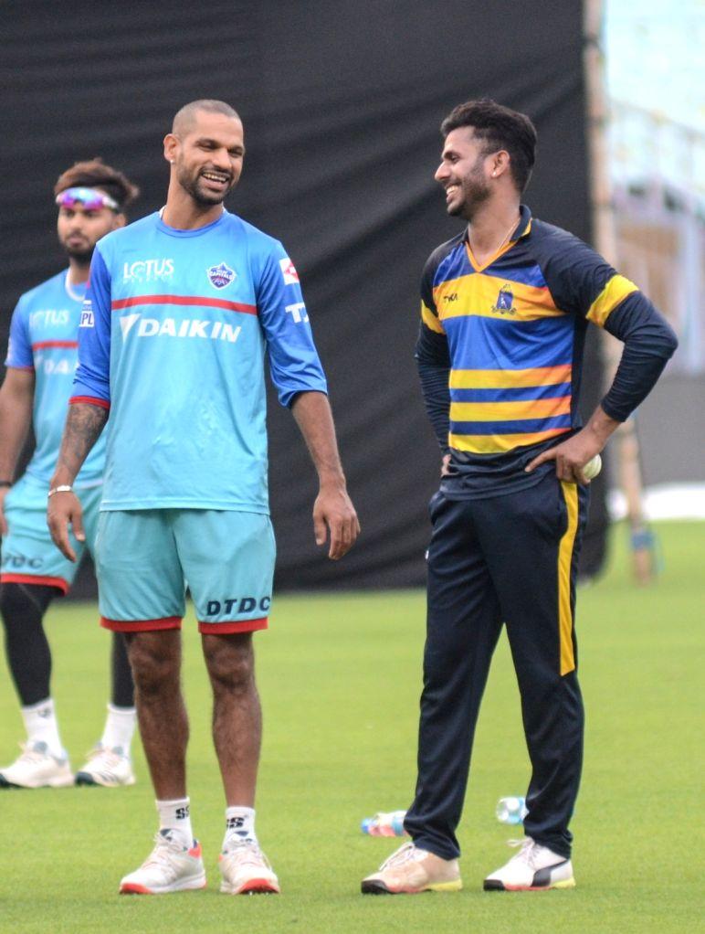 Delhi Capitals' Shikhar Dhawan and Manoj Tiwari during a practice session in Kolkata on April 11, 2019. - Shikhar Dhawan