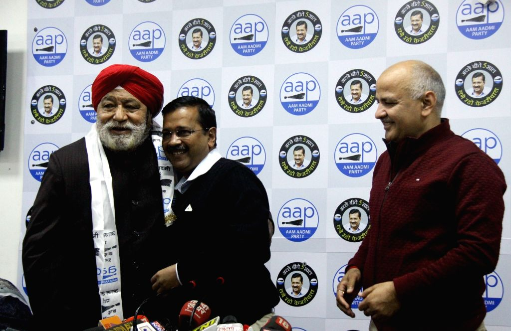 Delhi Chief Minister and Aam Aadmi Party (AAP) national convener Arvind Kejriwal and Deputy Chief Minister Manish Sisodia welcome four-time BJP legislator and former minister Harsharan ... - Manish Sisodia, Arvind Kejriwal and Harsharan Singh Balli