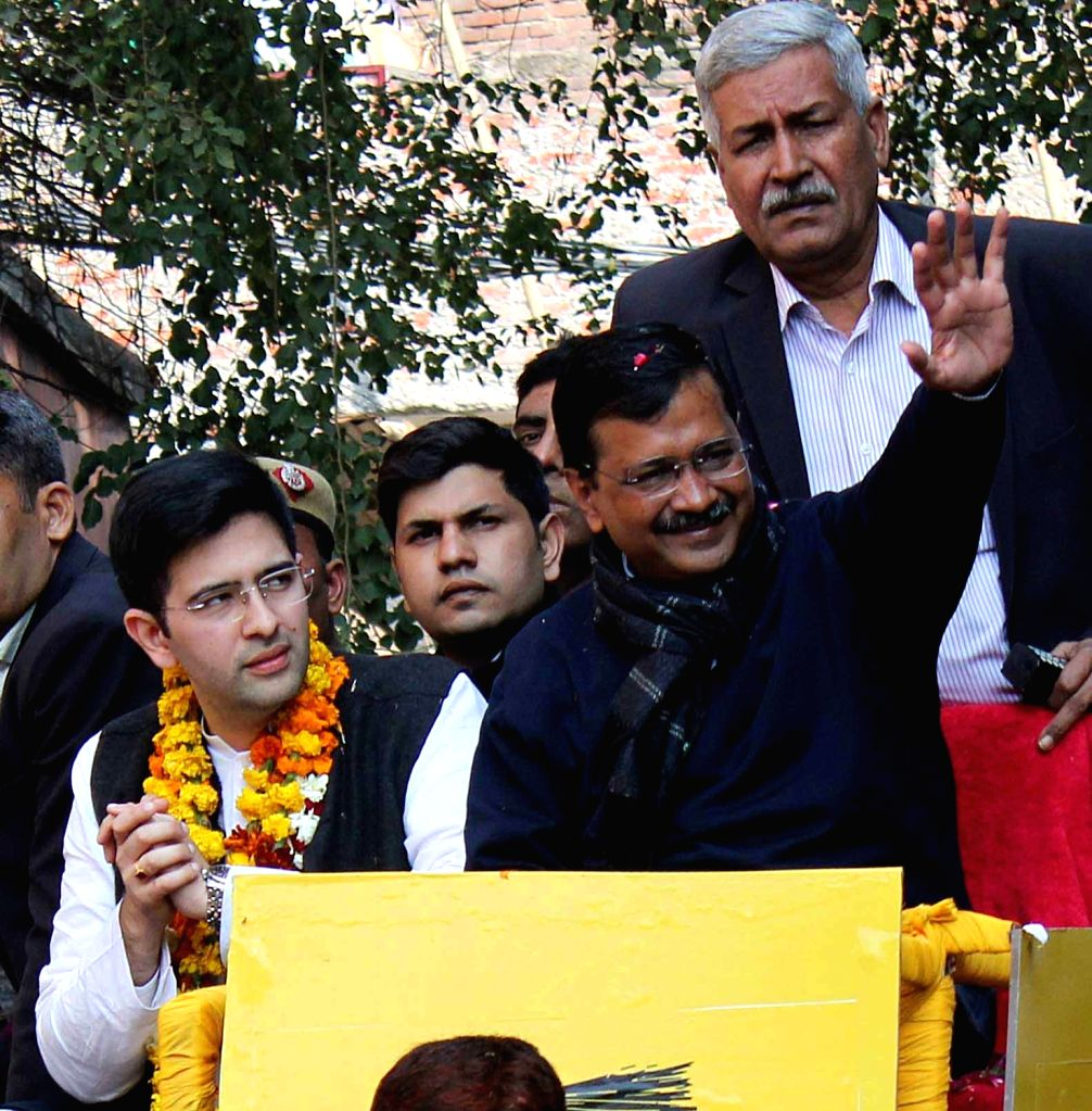 Delhi Chief Minister and Aam Aadmi Party (AAP) National convener Arvind Kejriwal accompanied by the party's Rajender Nagar candidate Raghav Chaddha, holds a roadshow ahead of the Delhi ... - Arvind Kejriwal