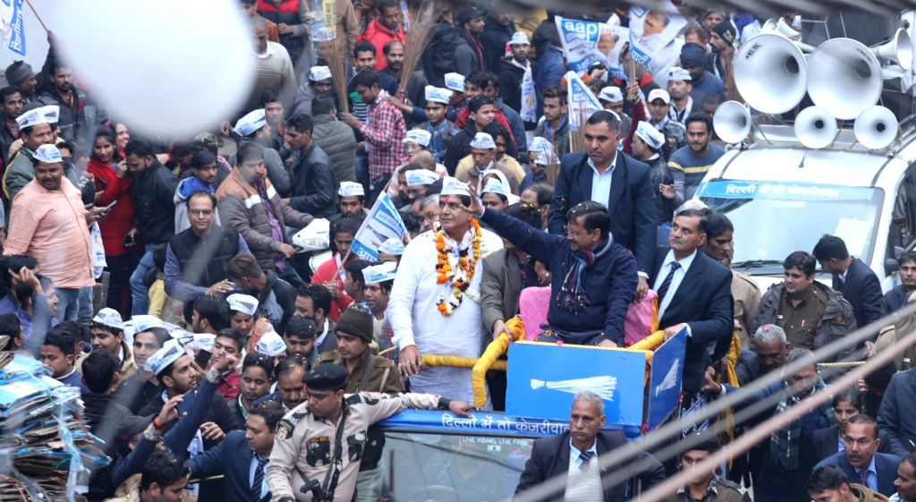 Delhi Chief Minister and Aam Aadmi Party convener Arvind Kejriwal accompanied by the party's candidate Naveen Choudhary (Deepu), holds a roadshow ahead of Delhi Assembly elections, at ... - Arvind Kejriwal and Naveen Choudhary