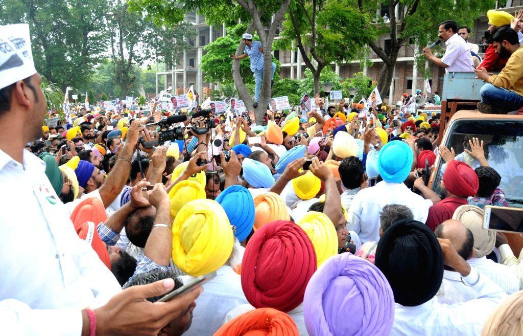 Delhi Chief Minister and Aam Aadmi Party leader Arvind Kejriwal addresses party supporters ahead of appearing before an Amritsar court in connection with a defamation case filed by Punjab ... - Bikram Singh Majithia and Arvind Kejriwal