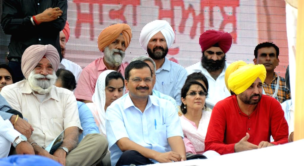 Delhi Chief Minister and AAP leader Arvind Kejriwal and party MP Bhagwant Mann during a programme organised to release AAP's manifesto for upcoming Punjab elections in Amritsar on July 3, ... - Arvind Kejriwal