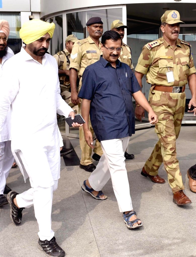 Delhi Chief  Minister and AAP leader Arvind Kejriwal along with AAP MP Bhagwant Mann arrives at Amritsar Airport on Sept 25, 2016. - Arvind Kejriwal