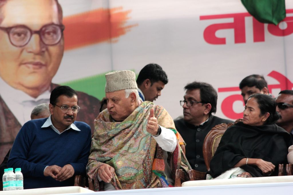 Delhi Chief Minister and AAP leader Arvind Kejriwal, West Bengal Chief Minister and Trinamool Congress supremo Mamata Banerjee and National Conference President Farooq Abdullah during a ... - Arvind Kejriwal and Mamata Banerjee